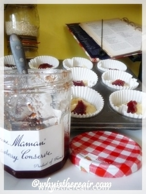 To make jam muffins, add a teaspoon of jam on top of the batter
