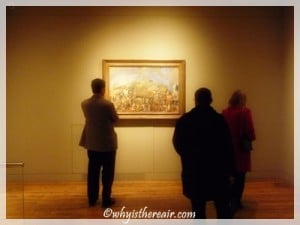 Visitors admire a painting at London's Courtauld Gallery