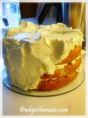 Covering the top and sides of the cake is an American method to retain moisture