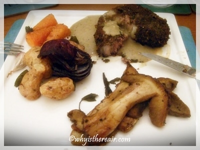 Barnsley lamb chops coated in gremolata breadcrumbs, sautéed ceps and roast vegetables, with mushroom gravy