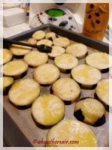Bake the aubergines after brushing them with oil