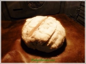 A loaf of Gluten Free Artisan Bread which has risen, been slashed and is ready for baking